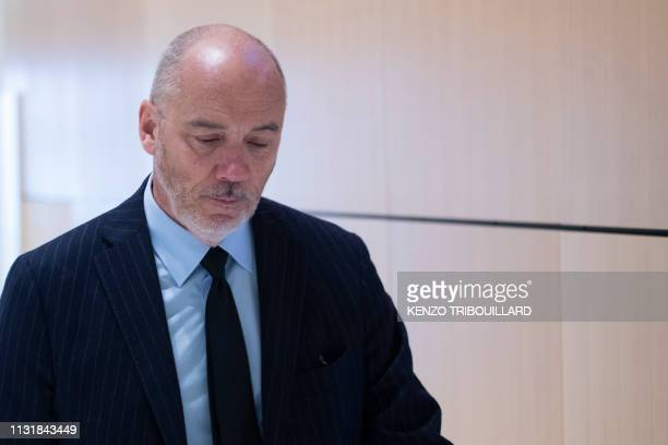 French telecom group Orange CEO Stephane Richard leaves after a suspension of the trial of French businessman Bernard Tapie for having defrauding...