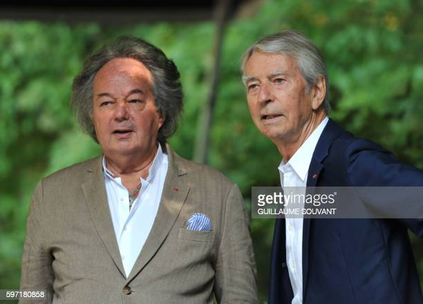 French television host JeanClaude Narcy and French writer Gonzague SaintBris look on during the 21th book fair La Foret Des Livres on August 28 2016...