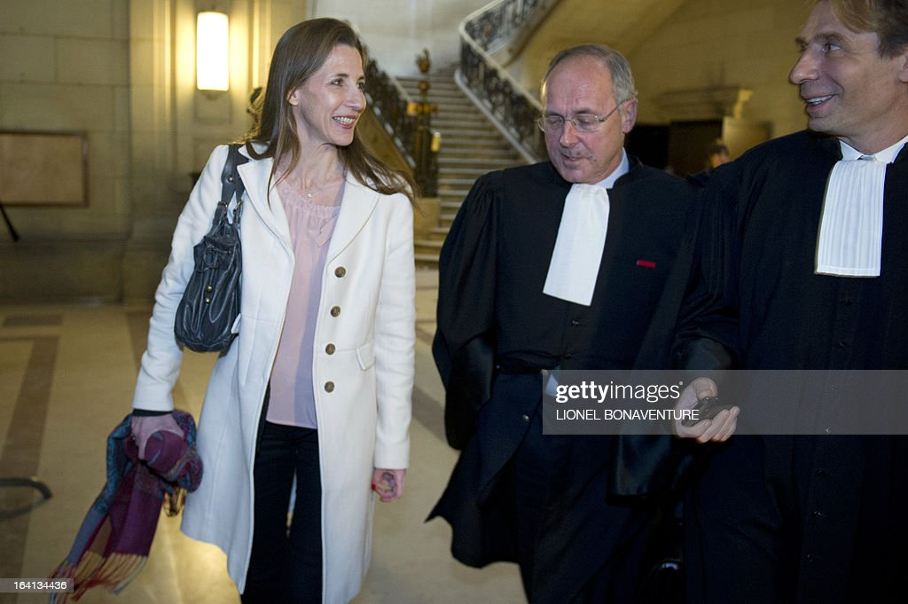 French television journalist Alix Bouilhaguet (L), one of the two suied French journalists, wait for the start of her trial with her lawyers, on March 20, 2013 at the Paris' courthouse, after Valerie Trierweiler, the president's 47-year-old partner, suied them for defamation and invasion of privacy, seeking 85,000 euros ($110,000) in damages and court costs, for their book of 'La Frondeuse' (The Rebel). As the trial opened on Monday, it emerged that Hollande sent a letter -- but not on paper with the presidential letterhead -- to the court denying an assertion in the book that he had reached out to the right in the mid-1990s. There was no official reaction from Hollande, but a source close to the president said he was in no way trying to influence the court and was simply providing testimony in the case.