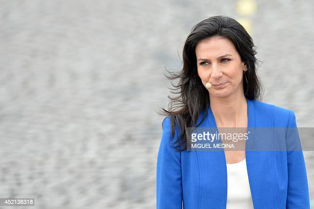 French television journalist Marie Drucker prepares to report the annual Bastille Day military parade from the Place de la Concorde in Paris on July...