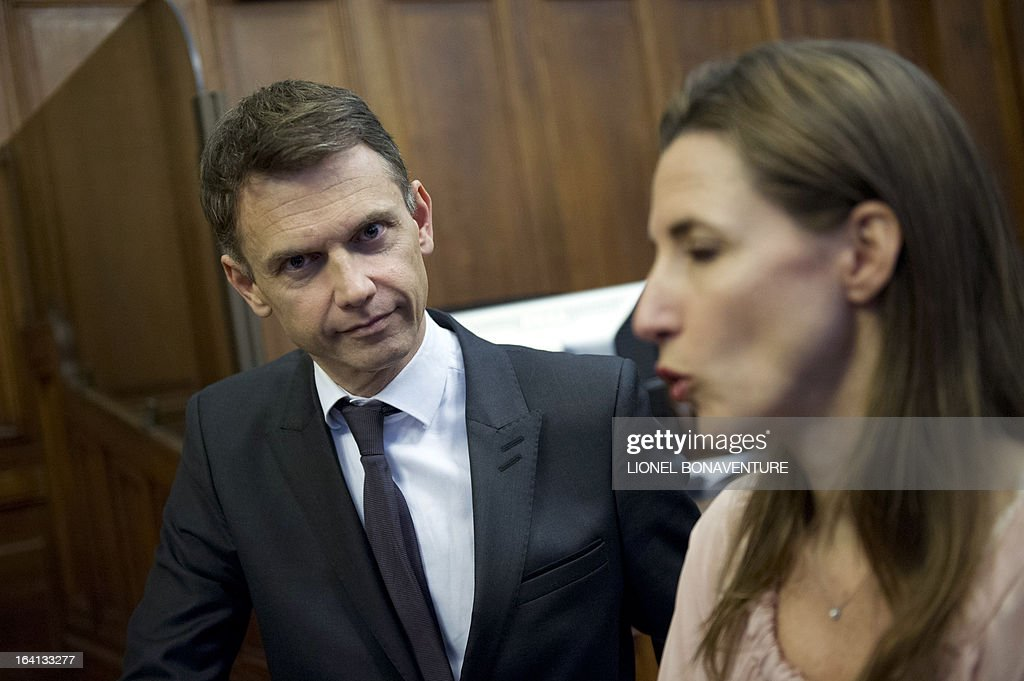French television journalists Christophe Jakubyszyn (L) and Alix Bouilhaguet (R), wait for the start of their trial on March 20, 2013 at the Paris' courthouse, after Valerie Trierweiler, the president's 47-year-old partner, suied them for defamation and invasion of privacy, seeking 85,000 euros ($110,000) in damages and court costs, for their book of 'La Frondeuse' (The Rebel). As the trial opened on Monday, it emerged that Hollande sent a letter -- but not on paper with the presidential letterhead -- to the court denying an assertion in the book that he had reached out to the right in the mid-1990s. There was no official reaction from Hollande, but a source close to the president said he was in no way trying to influence the court and was simply providing testimony in the case.