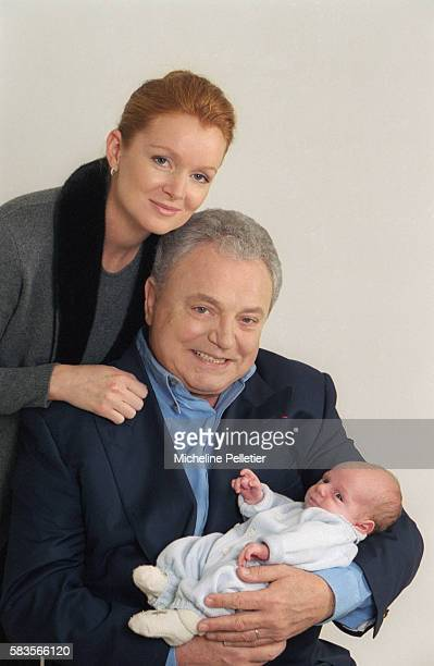 French television personality Jacques Martin and his wife Celine holding their onemonthold infant Clovis Jacques Martin is a television host animator...