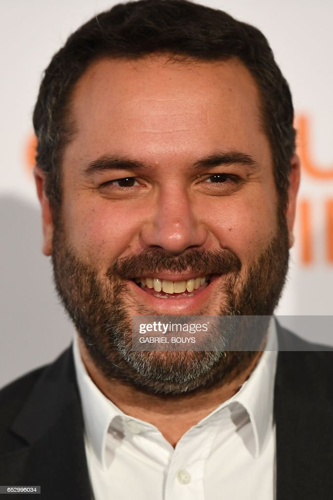 French television presenter and journalist Bruce Toussaint poses during the photocall for the premiere of the film 'Chacun Sa Vie' in Paris on March 13, 2017. The film is directed by French director Claude Lelouch. /