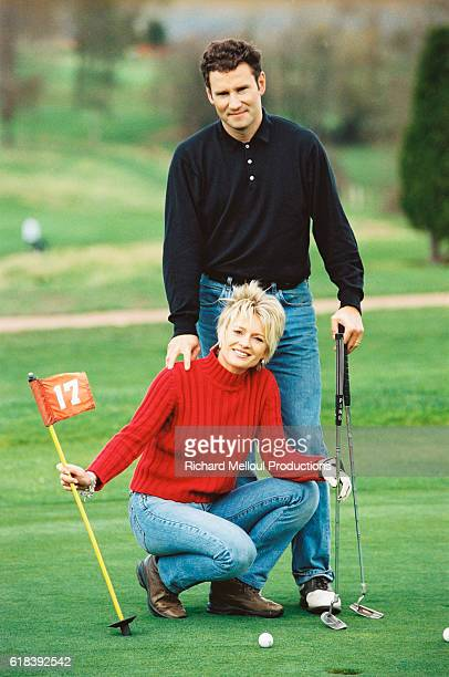 French television presenter Sophie Davant and sports presenter husband Pierre Sled enjoy some spare time on the putting green