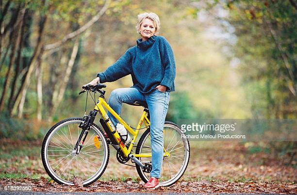 French television presenter Sophie Davant out for a cycle ride in the Normandy countryside