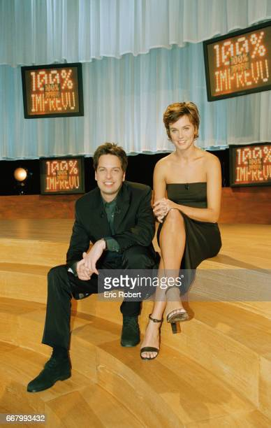 French Television Presenters Arnaud Poivre d'Arvor and Marine Vignes sit on the set of their television show 100% Imprevus