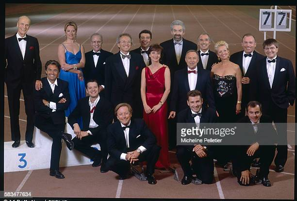 French television sports presenters united for a photo shoot on a race track Raymond Marcillac Gerard Holtz Catherine Pic Thierry Roland Thierry Rey...