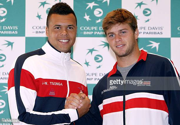 French tennis national team player JoWilfried Tsonga shakes hands with US player Ryan Harrison on April 5 2012 in Monaco after the drawing of the...