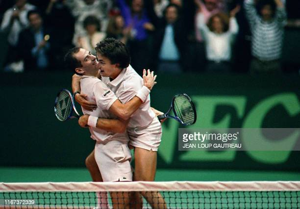 French tennis pair Henri Leconte and Guy Forget congratulate each other after their victory against American Pair Ken Flach and Robert Seguso here 30...