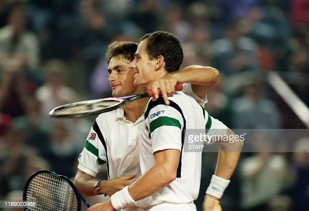 French tennis pair Henri Leconte and Guy Forget congratulate each other after defeating Israeli pair Amos Mansdorf and Gilad Bloom here 30 march 1991...