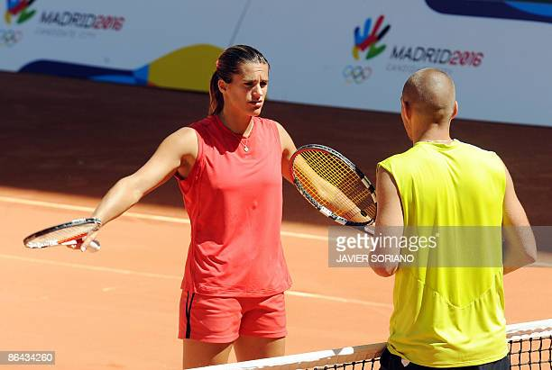 French tennis player Amelie Mauresmo chats with her coach during a training session at the Magic Box tennis court in Madrid on May 6 2009 Mauresmo is...