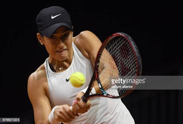 French tennis player Caroline Garcia returns to Ukrainian Marta Kostyuk during their 2018 Stuttgart Open round of 16 women's singles match against...