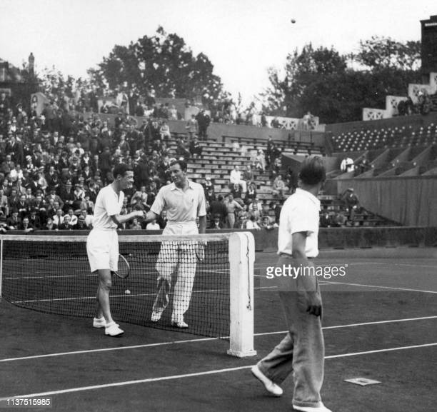 French tennis player Christian Boussus and British Fred Perry congratulate each other here in june 1935 during the French tennis championships at...