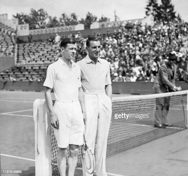 French tennis player Christian Boussus poses next to his opponent British Fred Perry here in may 1934 at Roland Garros stadium during the French...