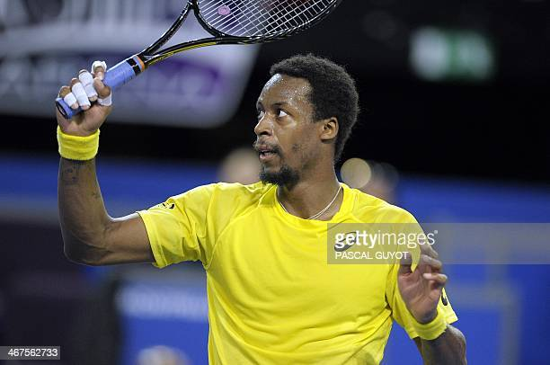 French tennis player Gael Monfils reacts after beating Denis Istomin of Uzbekistan at the Open Sud de France world tour ATP Series quarter final...