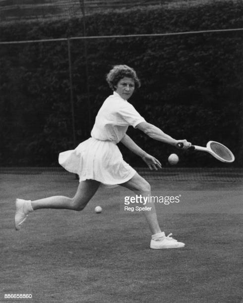 French tennis player Ginette Bucaille practising at the Wimbledon All England Lawn Tennis and Croquet Club in London for the 1956 Wimbledon...