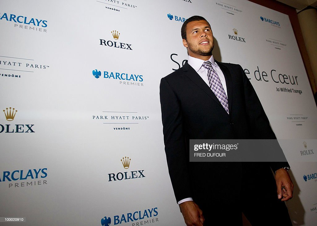 French tennis player Jo-Wilfrid Tsonga poses, on May 20, 2010, in a Paris hotel prior to a charity auction 'Ace de coeur' for 'Attrap'la balle' (Catch the ball) and 'Mecenat Chirurgie Cardiaque' (Cardiovascular surgery charity' French associations.
