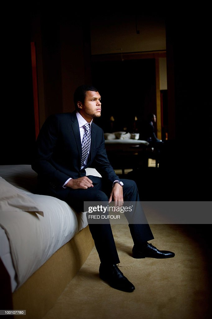 French tennis player Jo-Wilfrid Tsonga poses on May 20, 2010, in a Paris hotel prior to a charity auction for Attrap'la balle and Mecenat Chirurgie Cardiaque French associations.