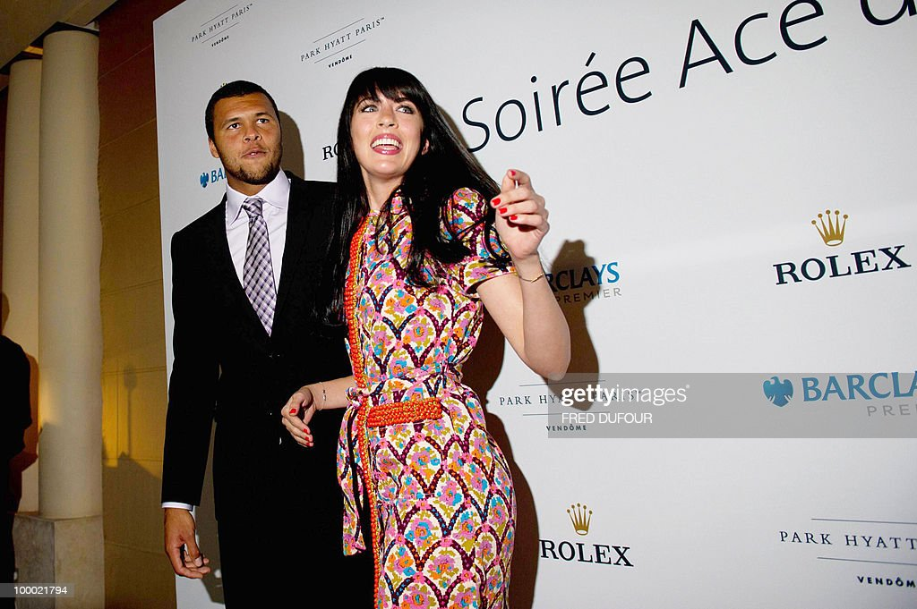 French tennis player Jo-Wilfrid Tsonga poses with French singer Nolwenn Leroy, on May 20, 2010, in a Paris hotel prior to a charity auction 'Ace de coeur' for 'Attrap'la balle' (Catch the ball) and 'Mecenat Chirurgie Cardiaque' (Cardiovascular surgery charity' French associations.