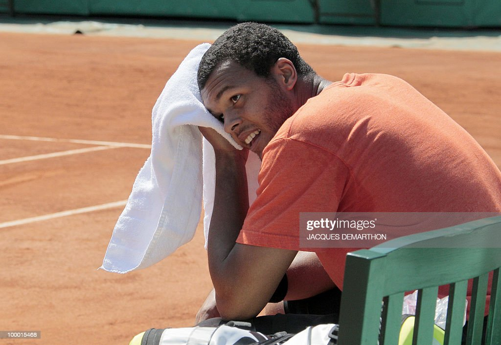 French tennis player Jo-Wilfrid Tsonga wipes his face during a trainning session at Roland Garros Philippe Chatrier's center court on May 20, 2010 in Paris, three days ahead of the French Open, the second Grand Slam tournament of the season.