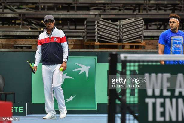 French tennis player JoWilfried Tsonga and France's team captain Yannick Noah attend a training session on November 21 2017 at the PierreMauroy...