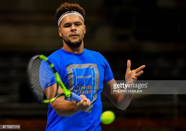 French tennis player Jo-Wilfried Tsonga practices during a training session on November 21, 2017 at the Pierre-Mauroy stadium in Villeneuve d'Ascq,...