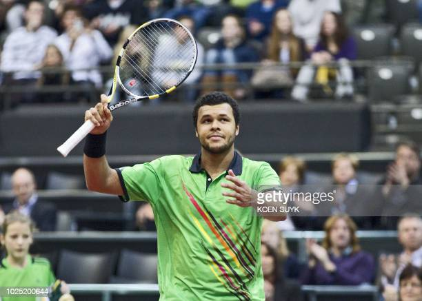 French tennis player JoWilfried Tsonga reacts during his match against Bulgarian Griogor Dimitrov at the ATP Open in Rotterdam on February 8 2011 AFP...