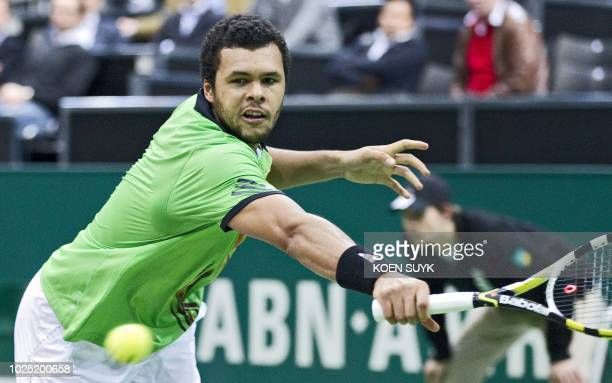 French tennis player JoWilfried Tsonga returns the ball to Bulgarian Griogor Dimitrov on the first round of the Rotterdam ATP Open on February 8 2011...