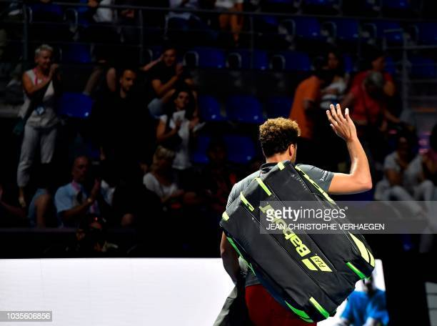 French tennis player Jo-Wilfried Tsonga waves to the crowd as he leave the court after being defeated by Germany's Peter Gojowczyk during their ATP...