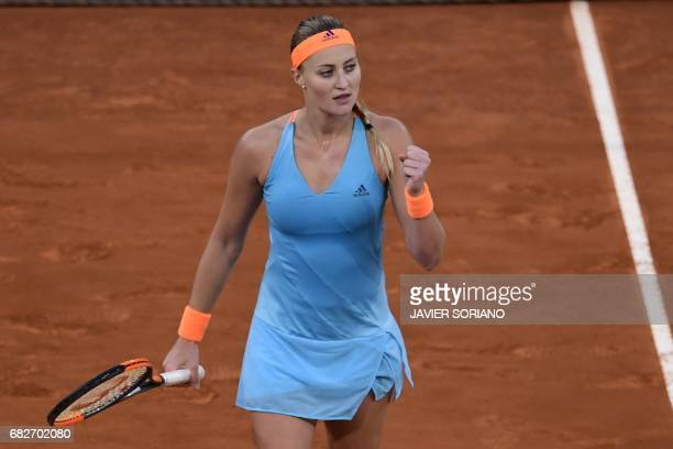 French tennis player Kristina Mladenovic celebrates a point against Romanian tennis player Simona Halep during the WTA Madrid Open final in Madrid on...