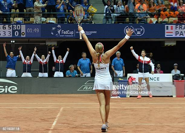 French tennis player Kristina Mladenovic celebrates after France won the Fed Cup semifinal double tennis match against the Netherlands in Trelaze...