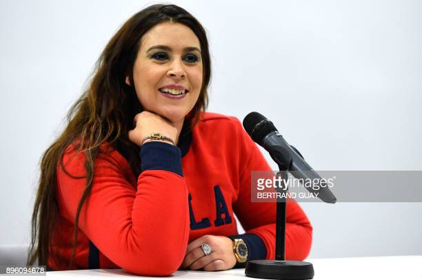 French tennis player Marion Bartoli delivers a press conference at the French Tennis Federation's national training centre in Paris on December 20...