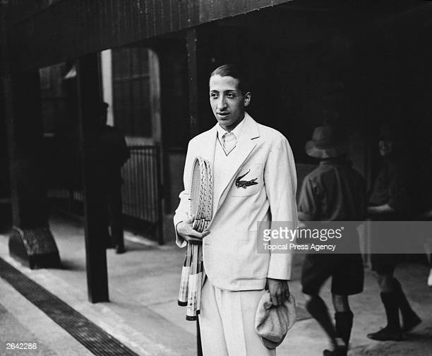 French Tennis player Rene Lacoste one of France's 'Four Musketeers' who won the Davis Cup in 1932 at Wimbledon He is wearing his embroidered...