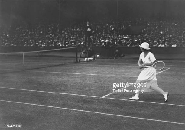 French tennis player Suzanne Lenglen in play at the Lawn Tennis Championships at Wimbledon, London, 1st July 1919. She won the Women's Singles title...