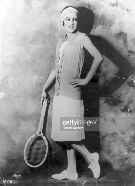 French tennis player Suzanne Lenglen modelling a new tennis outfit.
