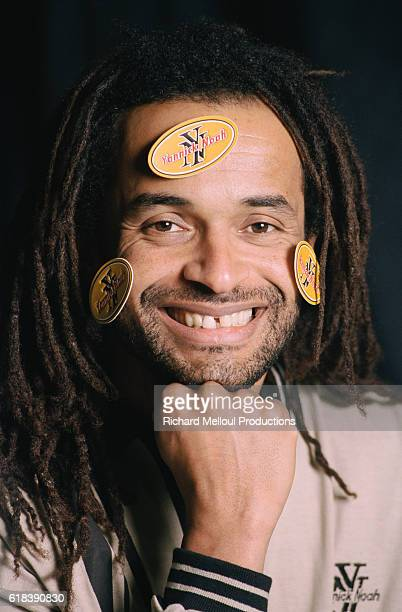 French tennis player Yannick Noah has stickers stuck to his face to promote his new clothing collection