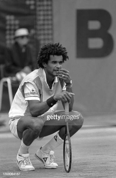 French tennis player Yannick Noah looks pensive in his match against compatriot Tarik Benhabiles during the French Open at Roland Garros stadium here...