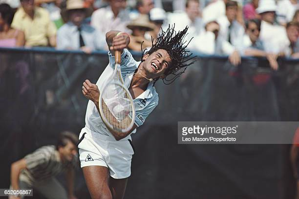 French tennis player Yannick Noah pictured in action competing to reach the quarterfinals of the 1983 US Open Men's Singles tennis tournament at the...