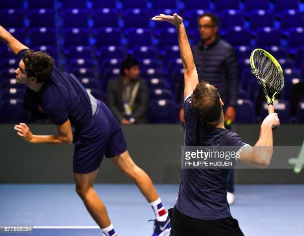 French tennis players PierreHugues Herbert and Richard Gasquet practice during a training session on November 23 2017 at the PierreMauroy stadium in...