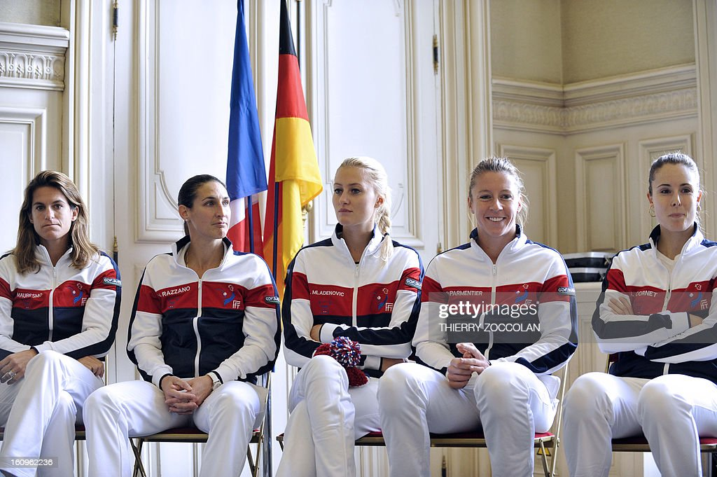 French tennis players (from L) team captain Amelie Mauresmo, Virginie Razzano, Kristina Mladenovic, Pauline Parmentier and Alize Cornet wait on February 8, 2013 for the draw for the Fed Cup World Group first round match against Germany held at Limoges' Town Hall.