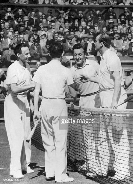 French tennis team composed of Jean Borotra and Jacques Brugnon is congratulated by German team with Goepfert and Menzel after winning the double...
