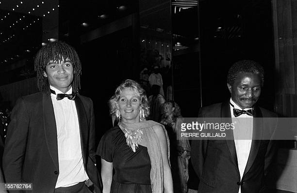 French tennisman Yannick Noah is pictured with his parents Marie-Claire and Zacharie during an official dinner with President of Cameroon Paul Biya...