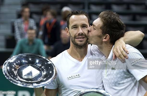 French tennismen Nicolas Mahut kisses Michael LLodra on the cheek after winning the final doubles match of the ABN AMRO World Tennis Tournament...