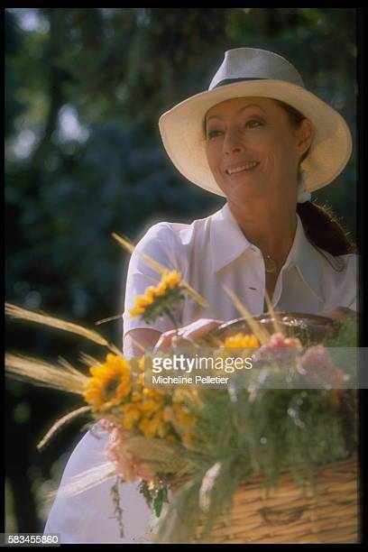 French theater actress Claudine Coster in the garden of her Plaisir home near Paris