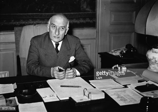 French theater director producer administrator critic and writer Jacques Copeau sits at his desk in his office as head of the ComedieFrancaise...