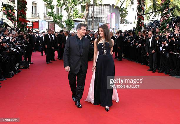French theatre and cinema director head of the jury Patrice Chereau and Indian actress Aishwarya Rai jury member arrive at the Palais des festivals...