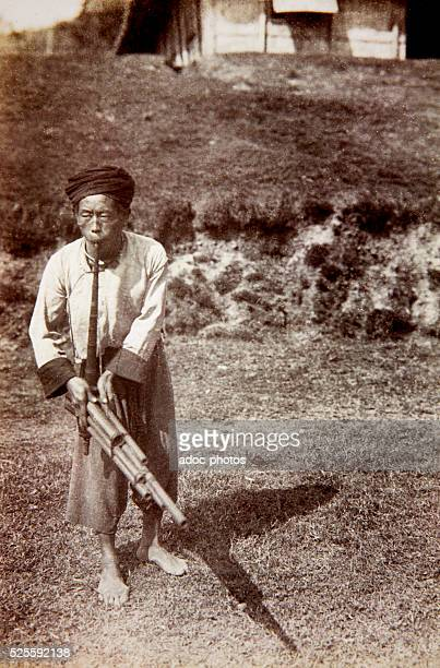 French Third Republic French colonization of Indochina The Mission Pavie A Hmong musician playing a lusheng in the region of the High Black River Ca...