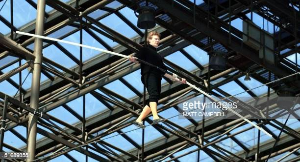 French tightrope walker Philippe Petit performs high above the floor of the Jacob Javits Convention Center in New York City 04 May 2002 during the...