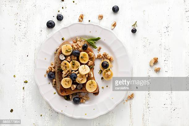 french toast with bananas - carolafink stock photos and pictures
