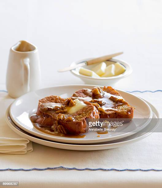 French toast with pecans, butter, caramel syrup